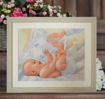 Вышитая нитками картина Материнское счастье